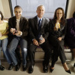 Group portrait of commuters on subway — Stock Photo