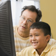 Father and son using a computer — Stock Photo