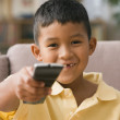 Young boy using a remote control — Stockfoto