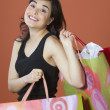 Stock Photo: Portrait of womcarrying shopping bags