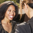 Two businesswomen talking — Stockfoto