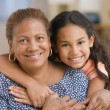 Mother and daughter hugging — Foto Stock #23239976