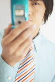 Businessman holding a mobile phone — Stock Photo