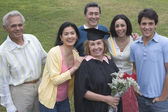Older graduate posing with family — Stock Photo