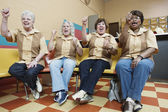 Women cheering at bowling alley — Stock Photo