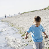 Boy walking on beach — Stock Photo