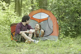 Young couple at their campsite — Stock Photo