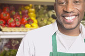 Male African American supermarket worker smiling — Stock Photo