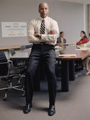 Businessman sitting on conference table — Stock Photo