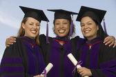 Three female graduates — Stock Photo