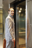 Businessman about to enter elevator — Stock Photo