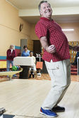 Happy man at bowling alley — Stock Photo