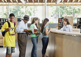 Waiting on line at the library — Stock Photo