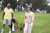 Golfing couple enjoying a laugh — Stock Photo