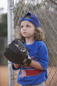 Girl with baseball mitt on sideline — Stock Photo