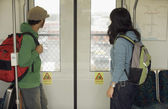 Young man and woman riding train — Stock Photo