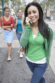 Girlfriends hanging out with mobile phone — Stock Photo
