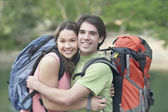 Young couple embracing outdoors — Stock Photo