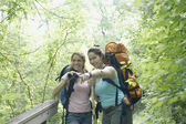 Young women hiking together in a forest — Стоковое фото
