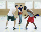 Jump ball in basketball game — Stock Photo