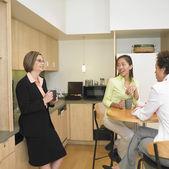Businesswomen talking in break room — Stock Photo