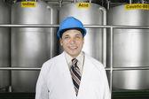 Portrait of man wearing hardhat and lab coat — Stock Photo