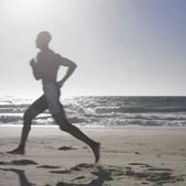 Man jogging at beach — Stock Photo
