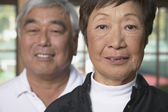 Senior Asian couple with woman in foreground — Stock Photo