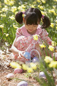 Girl gathering Easter eggs — Stock Photo