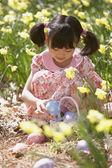 Girl gathering Easter eggs — Stock Photo