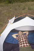 Man sleeping inside tent — Stock Photo