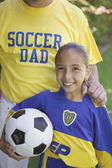 Soccer girl posing with her father — Stock Photo