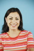 Headshot of young woman smiling — Stock Photo