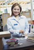 Librarian using stamper — Stock Photo
