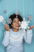 Young woman with snowflake mobile — Stock Photo