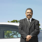 Portrait of businessman by car — Stock Photo