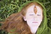 Close up of young woman lying on grass — Stock Photo