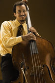 Man with double bass instrument — Stock Photo