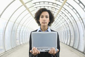 Portrait of businesswoman holding laptop — Stock Photo