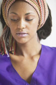Close up of woman wearing headscarf — Stock Photo