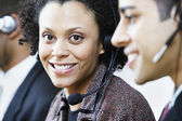 Portrait of businesswoman with earpiece — Stock Photo