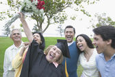 Graduate mother cheering her success — Stock Photo
