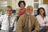 Four businesspeople sitting together — Stock Photo