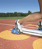 Side view of track athlete in starting blocks — Stock Photo