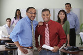 Group of office coworkers smiling at camera — Stock Photo