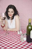 Portrait of woman in restaurant drinking wine — Stock Photo