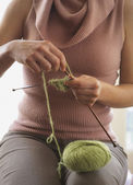 Midsection of woman knitting — Stock Photo
