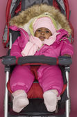 Baby girl wrapped up in winter clothes — Stock Photo