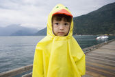 Portrait of boy in ducky raincoat — Stock Photo