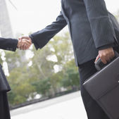 Low angle view of businesswomen shaking hands — Stock Photo